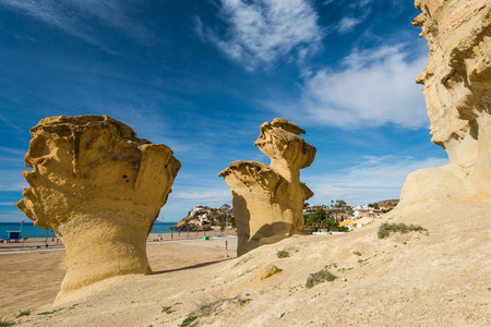 Erosion rock natural formations in Bolnuevo, Spain. Desert landscape at sunny day. Imagens - 74708659