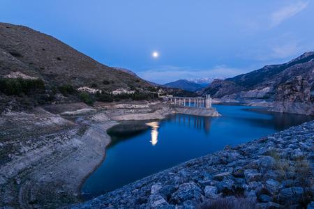 Reservoir Embalse de Canales in Granada, Spain at evening Stock Photo
