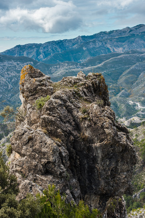 nerja: Sierra de Tejeda, Almijara y Alhama Mountains near Nerja, Spain. Panoramic vista over mountains in sunny day.
