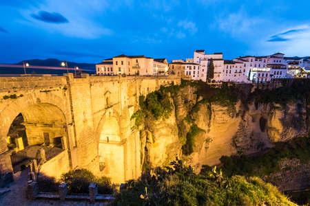 Evening view over iluminated famous Puente Nuevo New Bridge in Ronda, Spain Stock Photo