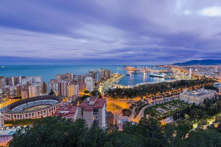 Illuminated skyline of Malaga in Spain at Costa del Sol in Andalucia Editorial