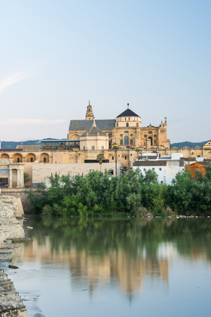 Roman Bridge and Mosque-Cathedral at twilight in Cordoba, Spain Stock Photo