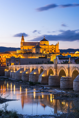 Cordoba, Spain view of the Roman Bridge and Mosque-Cathedral at twilight Stock Photo