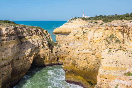 portugese: Algarve beautiful turquoise cost in Portugal, sandy beaches and yellow cliffs. Stock Photo