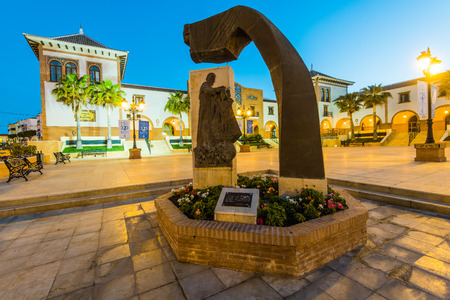 Palos de la Frontera, Spain - April 09, 2017:Beutiful city square ,illuminated at blue hour, from where Christopher Colomb set sail to discover America.