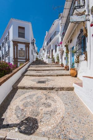 Historic streets of famous Frigiliana,Malaga province,Spain. Frigiliana is white village near Nerja. Editorial