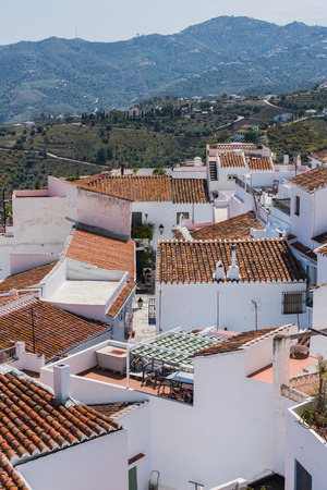 Panoramic view over Frigiliana famous white village near Nerja,Spain in Malaga province, famous for narrow streets
