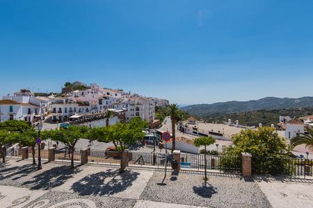 Frigiliana, Spain - May 05, 2017:  Panoramic view over Frigiliana village, Malaga, Spain famous white village.