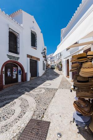 Frigiliana, Spain - May 05, 2017:  Historic streets of famous Frigiliana village near Nerja, Spain at sunny summer day.