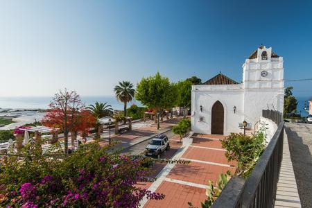 nerja: Maro, Spain - May 05, 2017:  Historic streets of Maro village near Nerja,Malaga,Spain with summer flowers in pots. Editorial