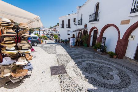 nerja: Frigiliana, Spain - May 05, 2017:  Historic streets of famous Frigiliana village near Nerja, Spain at sunny summer day.
