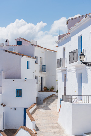 White facades in Frigiliana village, Andalusia,Spain in Malaga province. Frigiliana is famous for narrow streets with flowers.