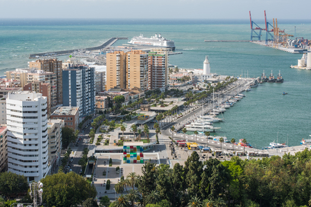 Malaga, Spain - April 20, 2017: New port in Malaga at sunny day with Lighthouse and yachts in harbour. Editorial