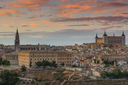 Toledo Alcazar and cathedral townscape at sunset, Spain.