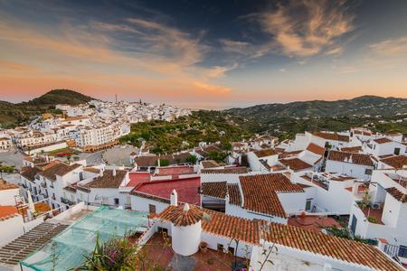 Cityscape of Frigiliana white villafe at sunset in Malaga province,Andalusia,Spain