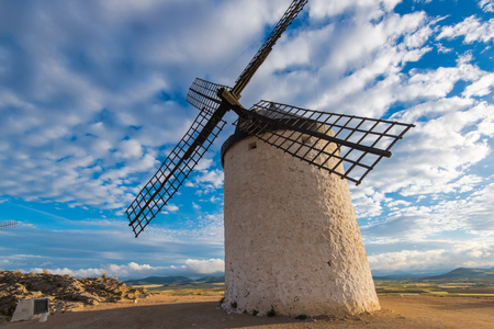 Medieval legendary windmill and summer sky