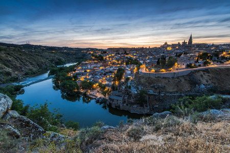 Illuminated cityscape of Toledo,Spain and river Tagus