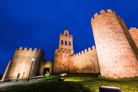 a nocturne: Illuminated gate to medieval town of Avila,Spain Stock Photo