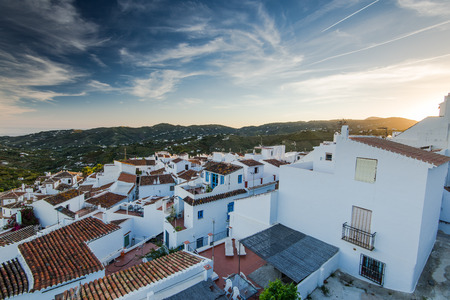 Sunset over Frigiliana white village near Nerja,Malaga,Spain with roofscape.