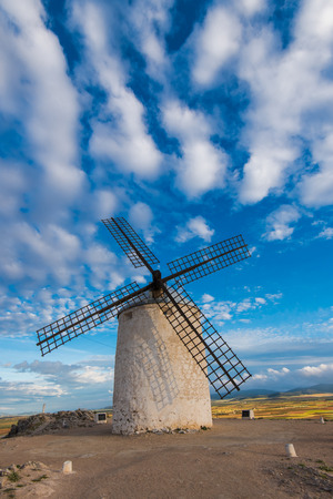 Ancient windmill on hill top with rural landscape and summer blue sky Stock Photo - 78589665