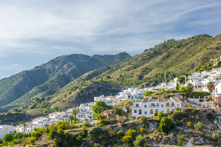Panoramic view over Frigiliana white village on hill top. Malaga province,Andalusia,Spain.