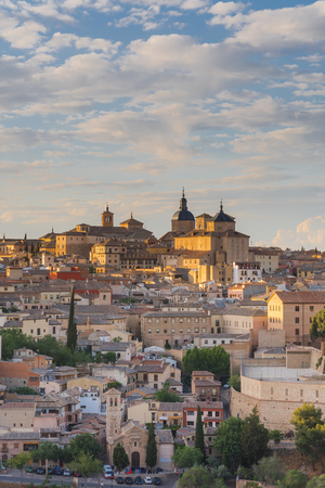 Close tele view on Toledo cathedral in gentle sun rays, Spain.