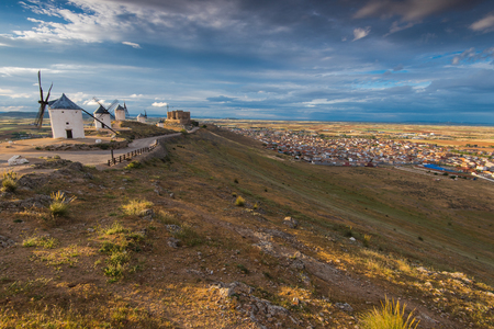 Windmills and Consuegra cityscae from  hill top