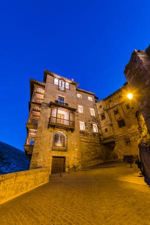 Hanging Houses or Casas Colgadas in Cuenca illuminated at evening,Spain Stock Photo