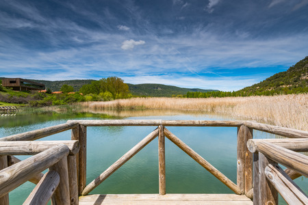 Timber footpath over lake Una,Spain