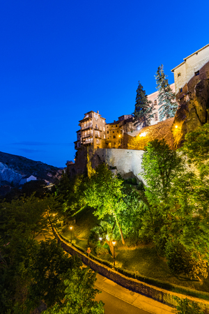Illuminated hanging houses in Cuenca,Spain Stock Photo