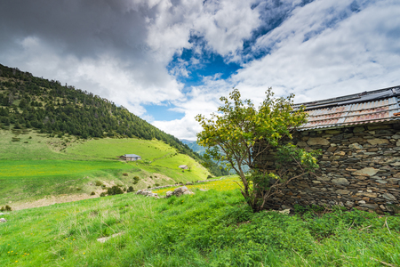 Rural dry stone farm house in Andorra Pyrenees at summer