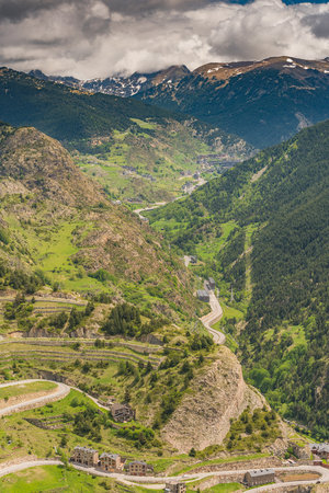 Aerial drone view over valley in Andorra with low clouds.