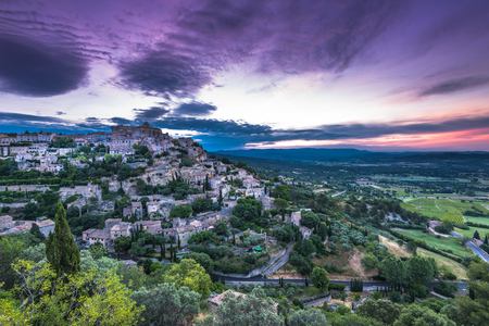 Rising sun over valley with Gordes town on hill top, Provence,France