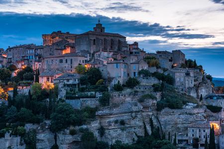 Gordes town in Provence,France illuminated at twilight 版權商用圖片