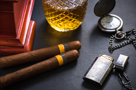 Cuban cigar with lighter and old watch. Stock Photo - 80554353