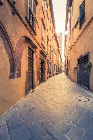 Toned image of narrow street in Lucca,Italy.