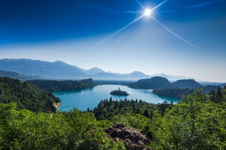 overlooking Bled lake panoramic vista in full summer sun.
