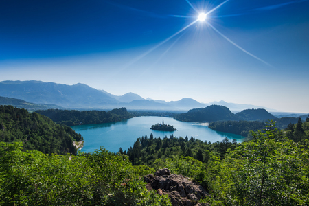 overlooking Bled lake panoramic vista in full summer sun.