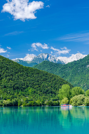 Julian Alps reflection in Most na Soci lake,Slovenia. Stock Photo - 81575290