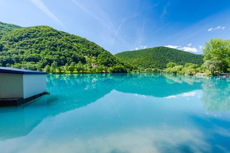 Julian Alps reflection in Most na Soci lake,Slovenia. Stock Photo