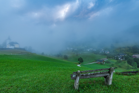 Empty bench overlooking Sorica village in Slovenia.