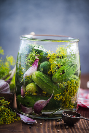 Glass jar filled with gherkins and cucumber for winter. Pickles recipe with ingredients. Banco de Imagens - 82083160