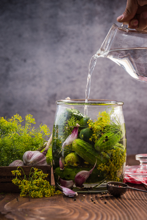 Glass jar with pickled cucumbers and gherkins, traditional recipe. Banco de Imagens