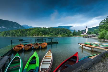 Colorful kayaks at lake Bohijn, Slovenia.