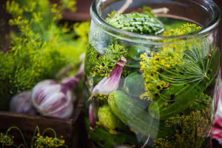 Glass jar filled with gherkins and cucumber for winter. Pickles recipe with ingredients. Banco de Imagens - 82083168