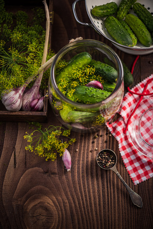 Ingredients for pickled cucumbers on wooden rustic table
