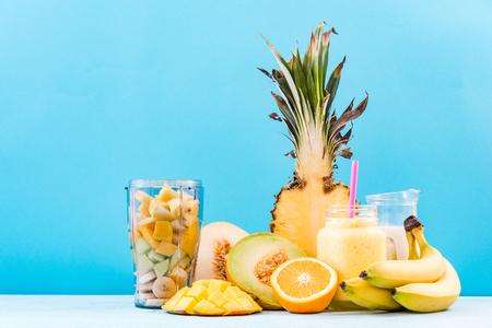 Fresh fruits and blender jar for smoothie.