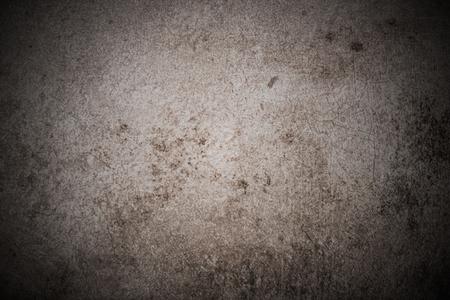 風化したコンクリートや石のスレートの背景に傷。