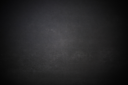 Dark weathered concrete or stone slate background. 版權商用圖片