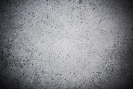 Grey weathered concrete or stone slate background.